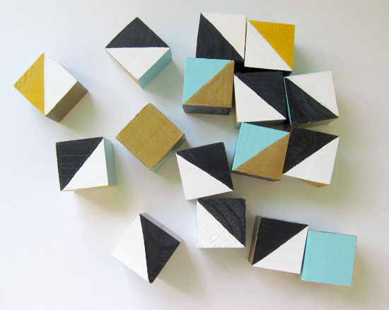 Jean painted wood cubes with a carefully chosen pallet, NOT primary colors