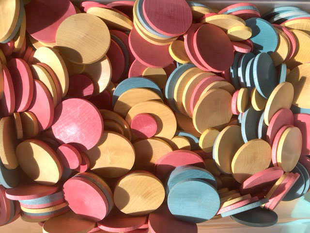 unpainted wood disks in two sizes colored in three colors with cloth dye