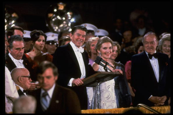 UNITED STATES - 1981: President and Nancy Reagan at podium at inaugural gala, Kennedy Center; Bob Hope & wife (L) Patti Reagan (in red, R) Omar Bradley, lower right. (Photo by Diana Walker/Time & Life Pictures/Getty Images)